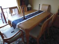 extending oak dining table with 8 matching chairs in un marked condition.cost £2000 ideal forxmas