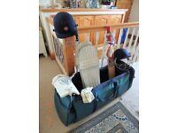 Slazenger cricket bag with bat, pads, 2 helmets, gloves etc