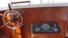 Freeman 23 4 Berth Motor Cruiser and Factory Built twin axle galvanised trailer