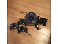 GameCube with 3 controllers and 1 memory card
