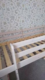 White stained wooden cabin bed with slide