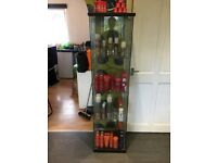 Glass display unit with dark wood top and bottom