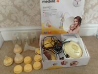 Medela electric breast pump and bottles