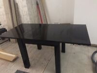 High gloss dining table and chairs with matching nest of tables and unit