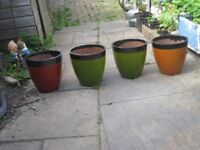 FOUR COLOURED EARTHENWARE POTS
