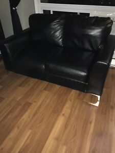Black leather coach and love seat .