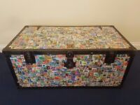 Large Antique Trunk hand covered in 2 extensive stamp collections. Unique, one of a kind collectable