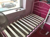 Pink heart shaped single bed