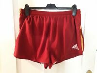 Adidas Running Shorts. Maroon with gold stripes. Size 40. Inner lining. Only worn a few times.