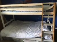 White bunk bed double bed at bottom of bunk