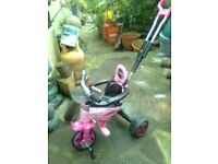 Injusa body trike, has an adjustable back handle, safety bars and a belt, rear storage basket