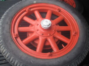 two vintage essex tires and woodspoked rims
