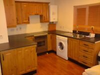 Lovely & Warm fully furnished two bedroom apartment with off street parking.