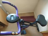 A foldable magnetic exercise bike with heart-rate, distance, etc monitor