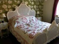 Shabby chic patchwork quilted bedspread. Pink and white