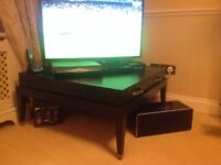 Black square coffee table with four drawers