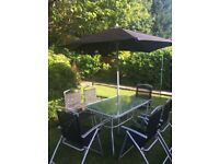 Six seater outdoor furniture with umbrella