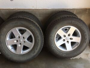 "5 Jeep Wrangler 17"" alloy wheels and Goodyear tires"