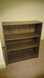 Matching brown bookshelves