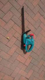 Bosch cordless hedge trimmer with battery and charger
