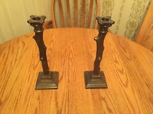 2 Bronze coloured matching candle holders.