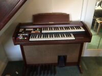 Technics E11 (L) Electronic Organ with Stool and includes original owner's manual/specifications.