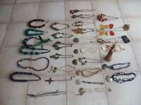 29 Necklaces & stand, new & as new, £25 the lot, or £1 each.