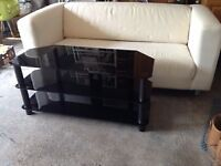 Black glass TV stand from Currys - cost £99 Size 1050 x 480 hi x 450 wide - Takes a 50kg TV