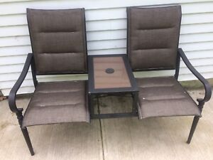 Double patio chair with attached table