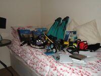 mixed bag of diving equipment includes manuals dive computer regulator all used