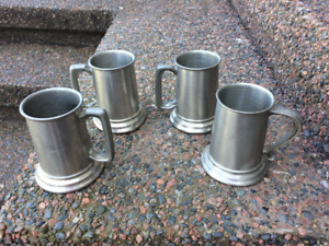 Four glass bottomed Pewter Beer Steins