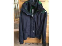 Navy Superdry jacket with dark green trim.
