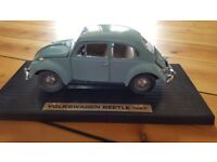 Light blue die-cast metal VW Beetle (1967) on display mount with box.