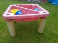 Water and sand table with bucket and spades