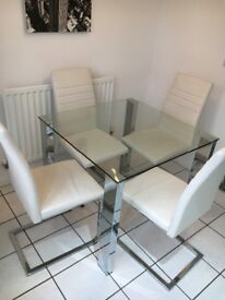 Glass dining table and chairs.