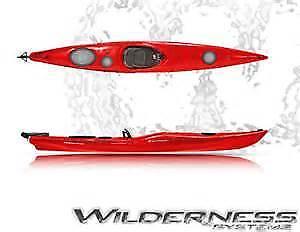 Kayak wilderness system tsunami 140 équipé racks en J et Thule