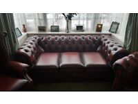 Chesterfield Oxblood red leather suite. 3 seated sofa, wingback arm chair, armchair.
