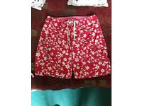 Women's red floral Animal board shorts size 14