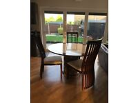 Brown and cream Marble Dining Room table with four chairs