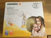 Medela swing breastpump plus extras