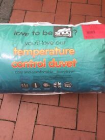 Brand new in packets silent night duvets