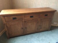 Solid oak side board 1 year old. Immaculate condition