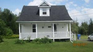 Two bedroom house for rent on acre lot.