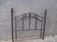 Ornate metal headboard
