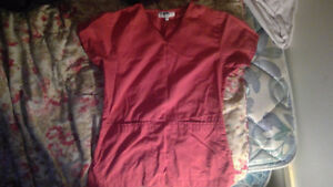 Gently used womens scrub tops.