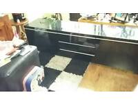Black gloss tv unit.