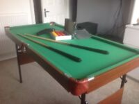 Pool/snooker table and cues for sale. 4 ft. Hardly used, mint condition.