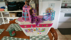 Barbie boat and Barbie van with barbies