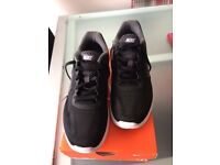 Ladies black Nike trainers size 5