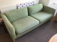 Pair of Ikea 'Vimle' sofas in green.